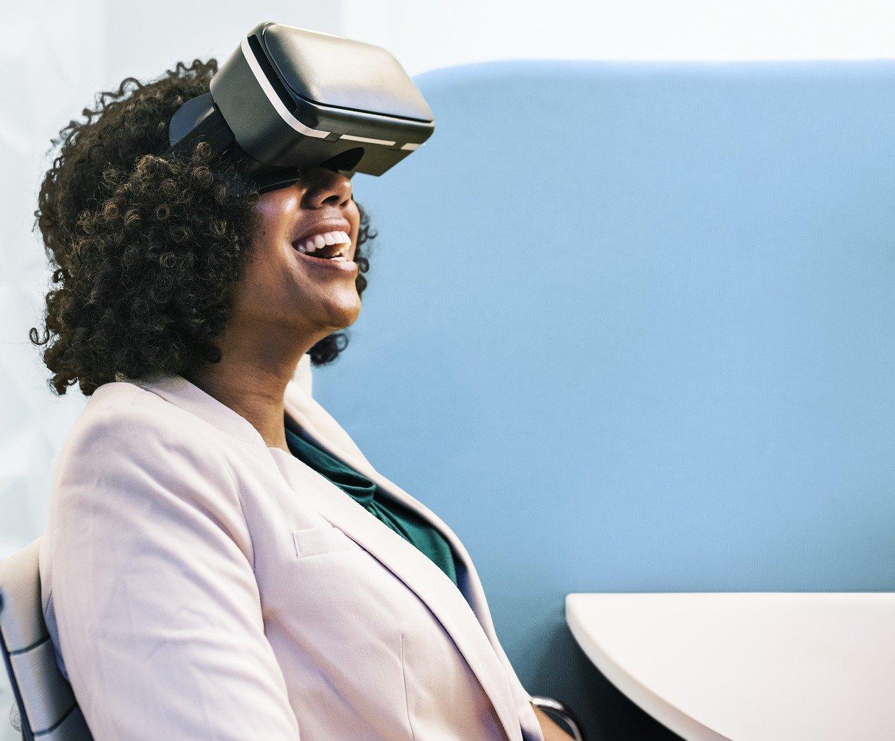 A woman puts on a virtual reality goggles